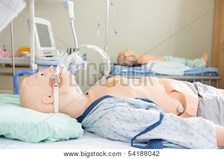 Medical dummies in hospital room