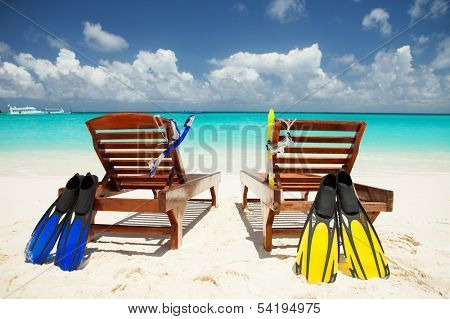 Two deckchairs on the tropical beach