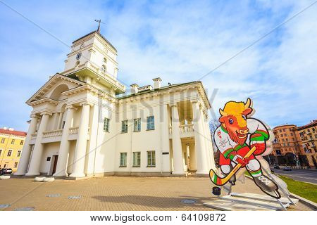 Volat, The Official Mascot Of The 2014 Iihf World Championship In The Background The Town Hall In Mi