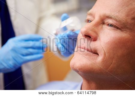 Man Having Botox Treatment At Beauty Clinic poster