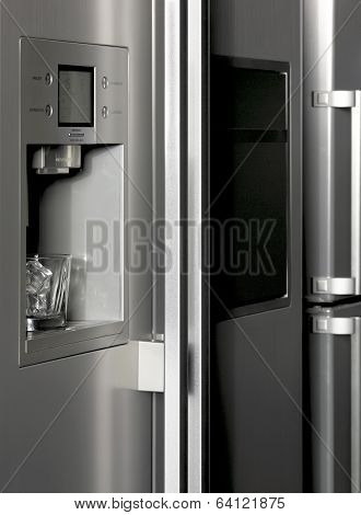 Fridge Detail With Ice Dispenser And Glass