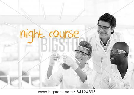 The word night course against scientists working in laboratory
