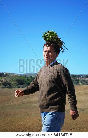 Man with aspargus bundle, Spain.