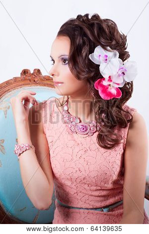 Charming Girl In A Pink Dress And With Flowers In Her Head