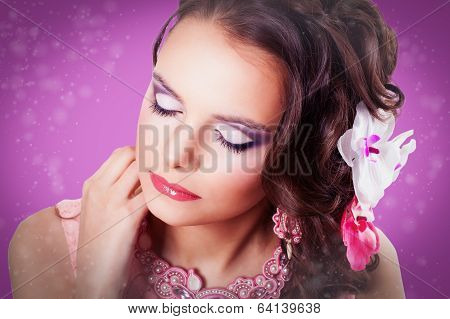 Beautiful Purple Makeup On The Girl With Closed Eyes On Purple Background