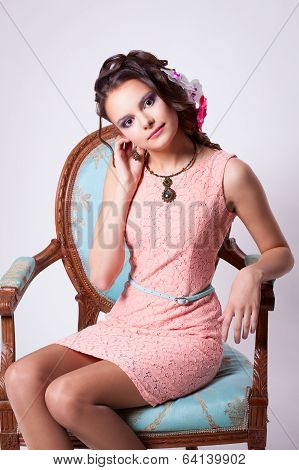 Gentle Woman In A Pink Dress And Green Necklace Earring Shows