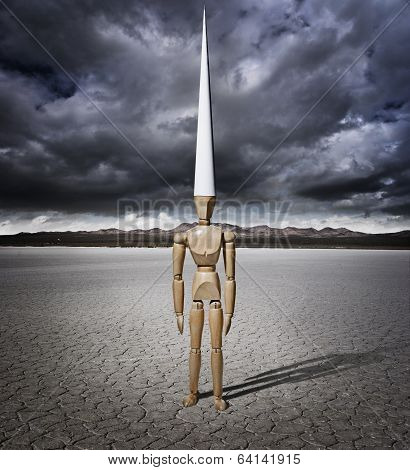 Artist manikin with Dunce cap in a dry lake bed with storm clouds poster
