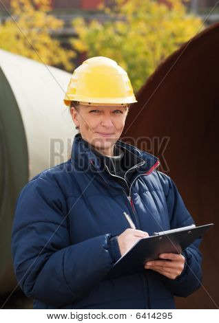 Construction Engineer Takes Notes