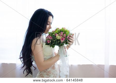 Beautiful Young Bride In A White Dress With A Wedding Bouquet Of Pink Roses. Last Preparations For T