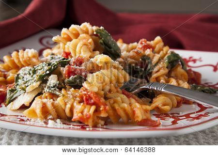 Fusilli Pasta With Tomatos And Fresh Baby Spinach