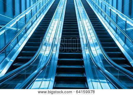 Escalator Going Up Stairs