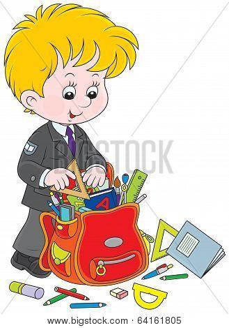 Schoolboy completing his schoolbag