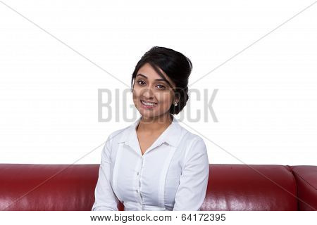 Smiling businesswoman sitting on sofa