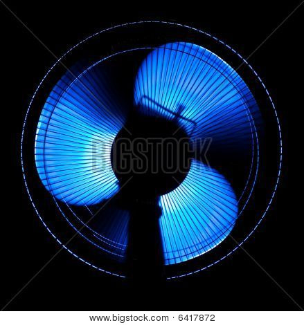 big office fan in blue light isolated on black poster