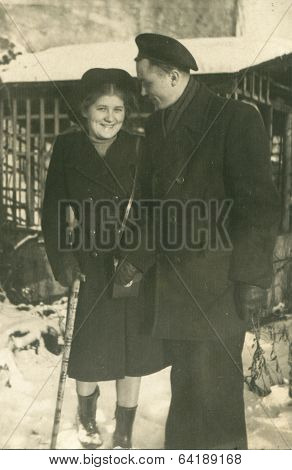 Poland, circa 1949: a romantic couple posing for a photograph, circa 1949