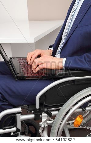 Businessman In A Wheelchair With Laptop