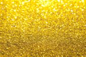 Gold Glitter with selective focus near 2/3 from top poster