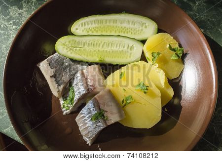 Fillet Of A Herring, Potatoes And Cucumbers