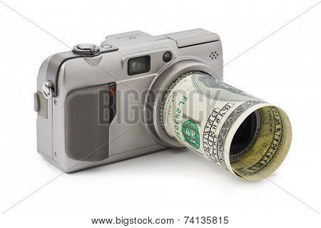 Photo camera and money isolated on white background