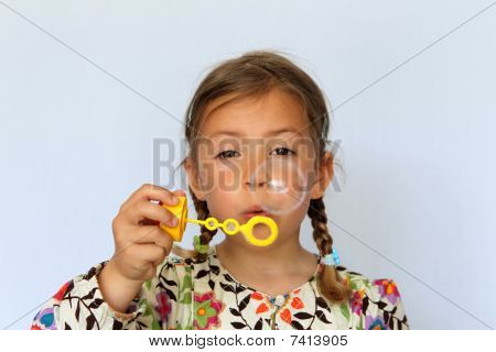 Girl blowing a bubble