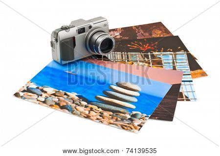 Camera and photo printouts (my photos) isolated on white background