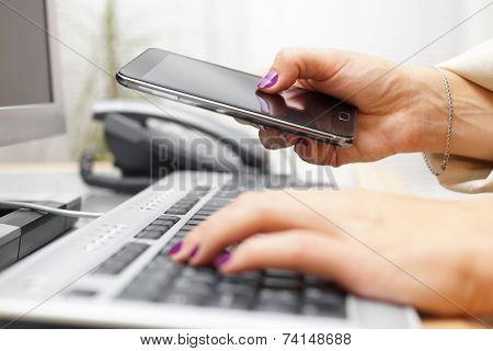 Woman Is Transferring Application From Computer To Smart Mobile Phone