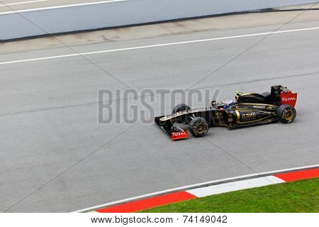 SEPANG, MALAYSIA - APRIL 8: Vitaly Petrov (team Lotus Renault) at first practice on Formula 1 GP, April 8 2011, Sepang, Malaysia