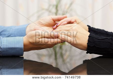 Man  Holding Woman Hands. Love And Care Concept