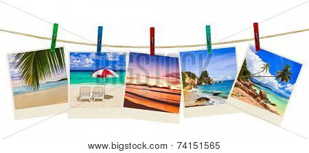 Vacation beach photography on clothespins isolated on white background