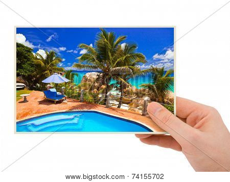Beach photography in hand (my photo) isolated on white background