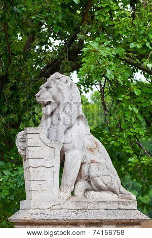 Stone lion with a board in paws