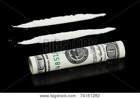 Cocaine and money isolated on black background