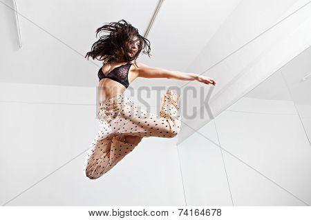 Jumping brunette woman on a trampoline