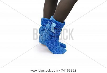 female legs in warm slippers on a white background poster