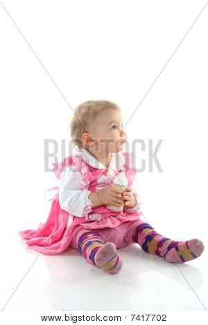Pretty Baby Girl Is Drinking Milk In A Bottle Isolated