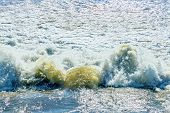 The rapid flow of water frothed in the sun poster