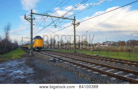 Train passing a rail crossing in a city