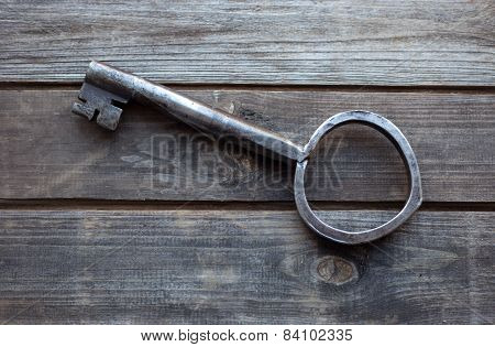 Big Key On Wooden Rustic Table