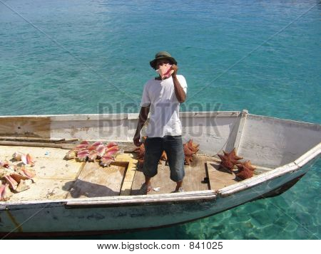 Man Selling Conch Shells In Boat In Nassau, Bahamas