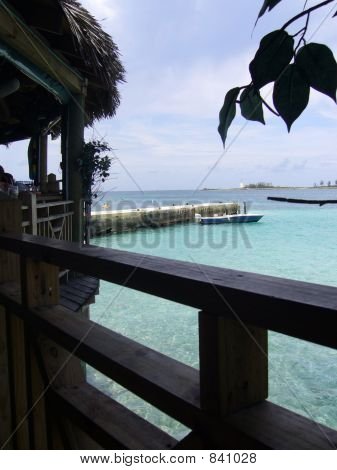 Water Framed By Trees And Hut In Nassau