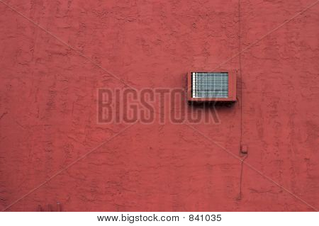 Red Stucco Wall With Air Conditioning Unit