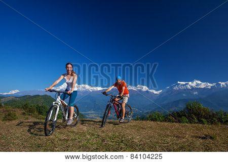 Biker family in Himalaya mountains Anapurna region poster