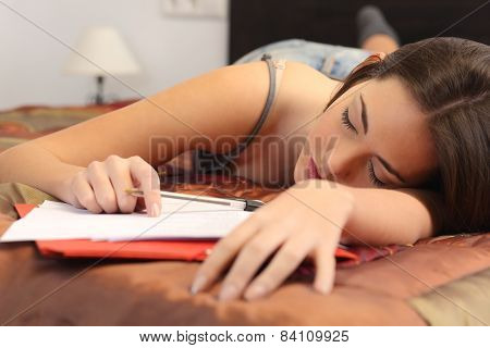 Student Tired And Sleeping In Her Room