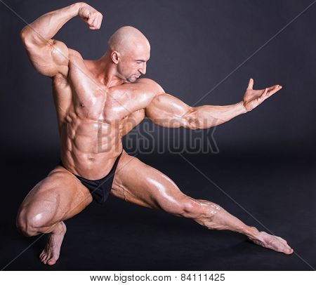 Bodybuilder is posing showing his muscles. Force relief muscle courage virility bodybuilder bodybuilding. poster