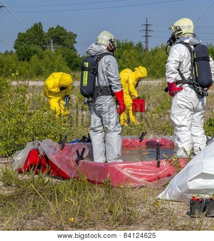 Hazmat team members have been wearing protective suits to protect them from hazardous materials
