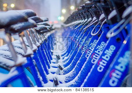 Citi Bikes In New York City At Docking Stations with Snow