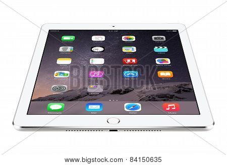 Angled Front View Of Apple Silver Ipad Air 2 With Ios 8 Lies On The Surface, Designed By Apple Inc.