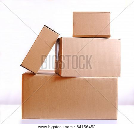 Four Cardboard Boxes Isolated