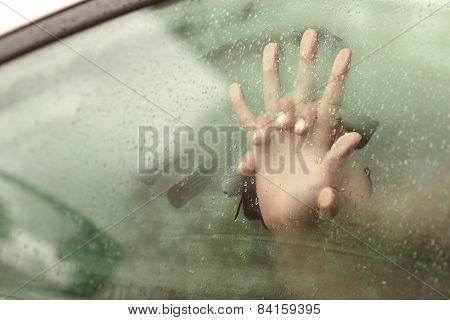 Couple holding hands having sex inside a car with a steamy window poster