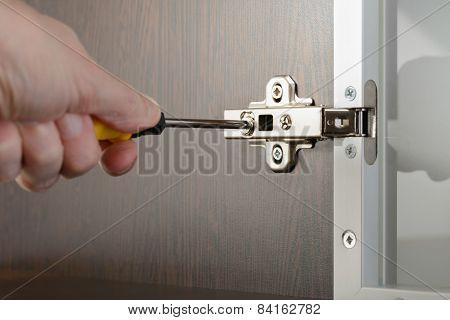 Adjusting A Concealed Hinge